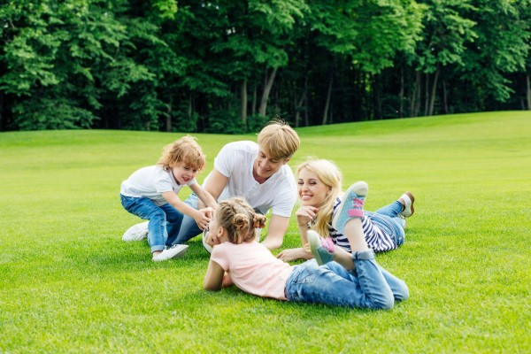 Happy family resting in park