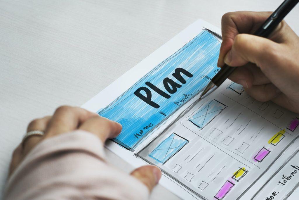 woman writing a website plan